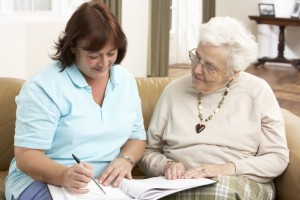 2194406-senior-woman-in-discussion-with-health-visitor-at-home