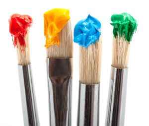 four paintbrush with color, tool for painting against white background